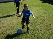 child playing soccer sport